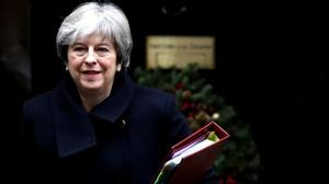 May to push EU for Brexit advance, despite defeat at home