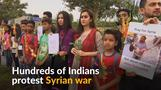 Hundreds form human chain in India to condemn Syrian war