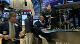 Wall Street slides on trade talk uncertainty