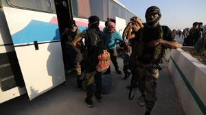 Syrians evacuated from Golan border reach rebel checkpoint in Hama