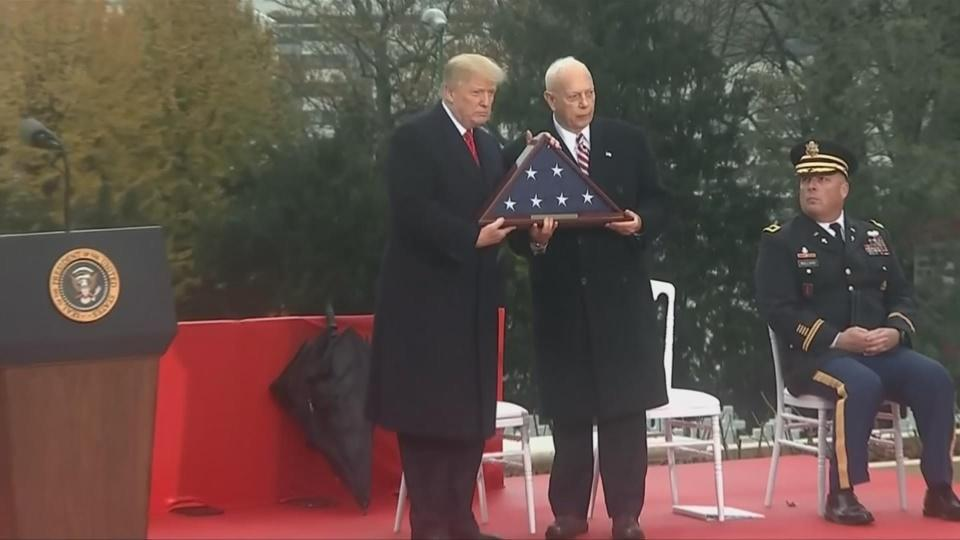 Trump honors WWI soldiers a day after rain debacle