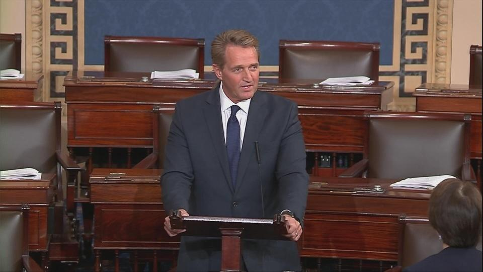 "Flake warns of ""threats"" to democracy in Senate farewell"