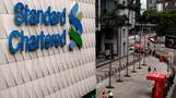 Standard Chartered sets aside $900 mln to cover fines