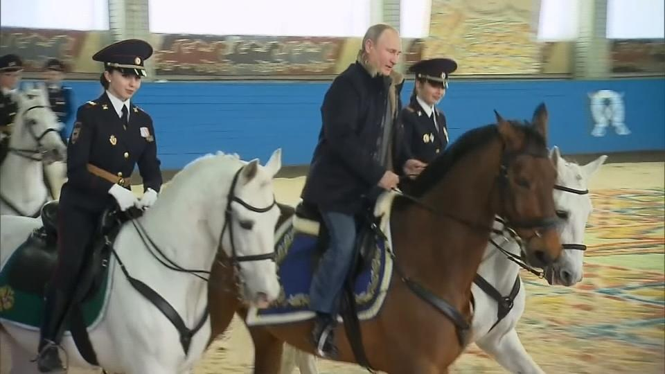 Russia's Putin rides tall in the saddle for Women's Day