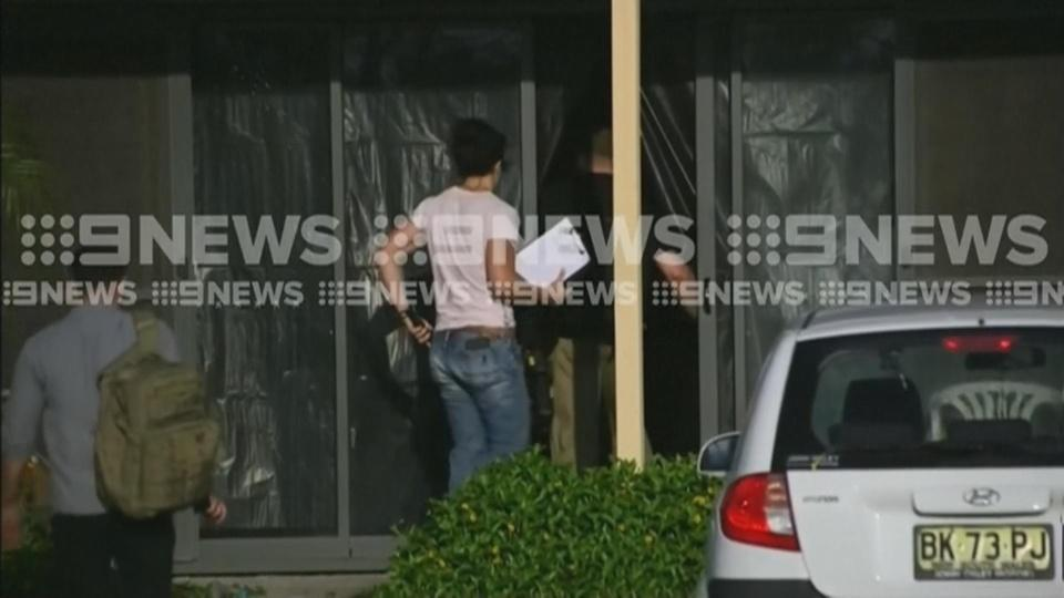 AU police search homes linked to NZ shootings