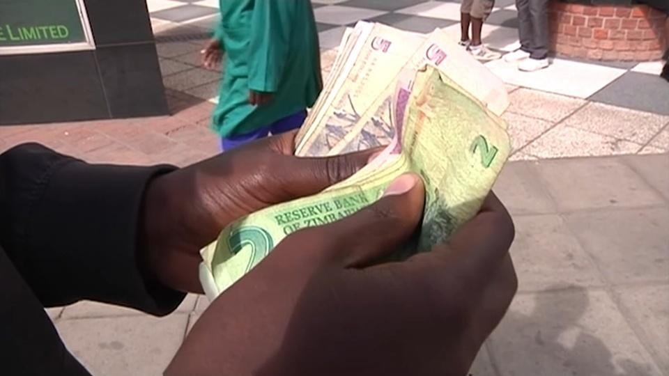 Zimbabweans wary as dollarisation decade ends