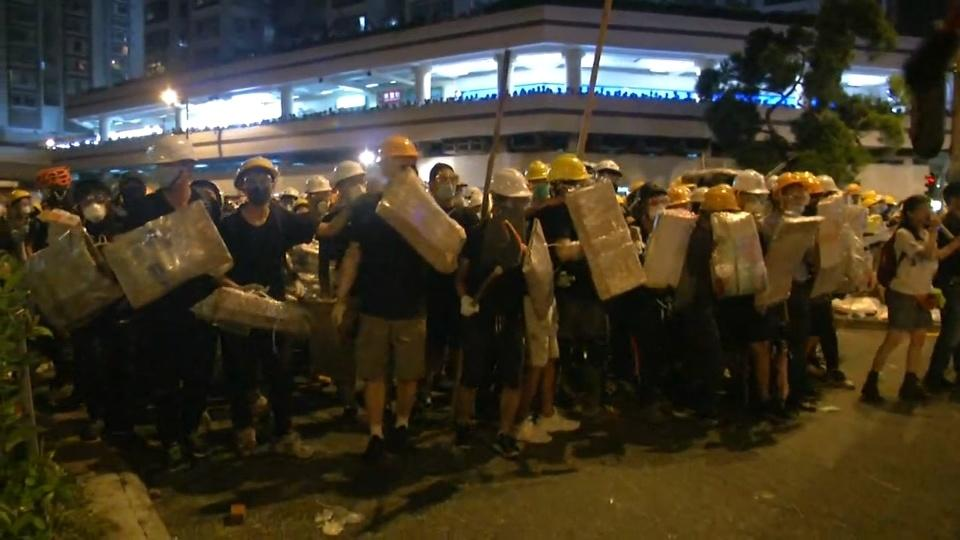 Hong Kong anti-extradition protesters fire up fight in the suburbs