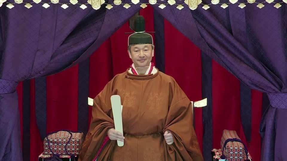 Japan's emperor takes the throne in ancient ceremony
