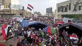 Defying curfew and crackdown, thousands of protesters gather in Baghdad
