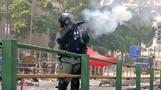 Hong Kong police lay siege at fortified university