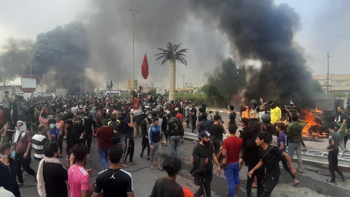 Mourners bury deadas death toll rises in Iraq