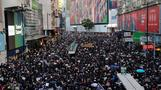Thousands march in Hong Kong, govt urges calm