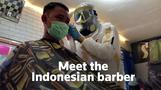 Indonesian barber gears up in handmade protective suit