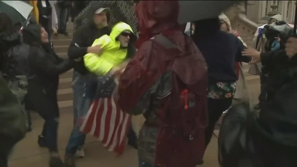 Scuffles at Michigan anti-lockdown protest