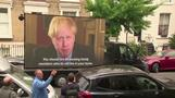 Screen showing Boris Johnson videos parks outside Cummings' home