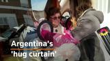 Plastic 'hug curtain' in Argentine retirement home