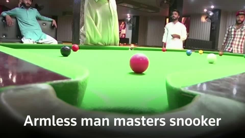 Armless snooker player masters game with his mouth