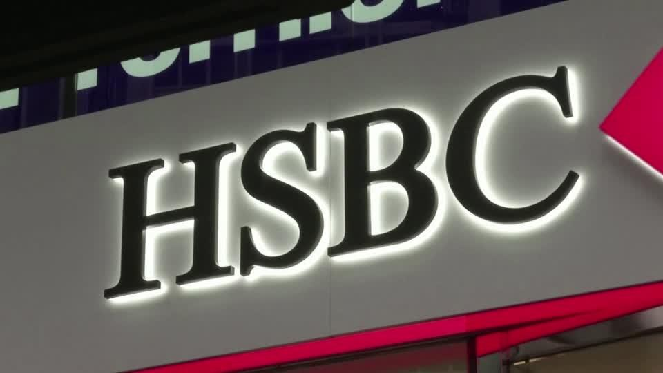 HSBC to revamp business model as profits dive
