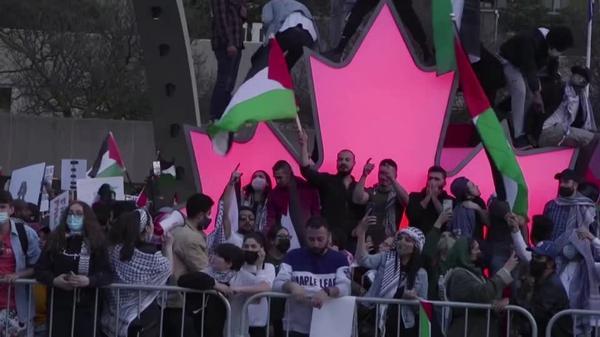 Pro-Palestine and pro-Israel demonstrators clash in Toronto