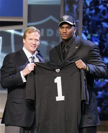 First pick overall in the 2007 NFL Draft, Louisiana State quarterback JaMarcus Russell, stands with NFL Commissioner Roger Goodell (L) after being chosen by the Oakland Raiders, in New York April 28, 2007. REUTERS/Brendan McDermid