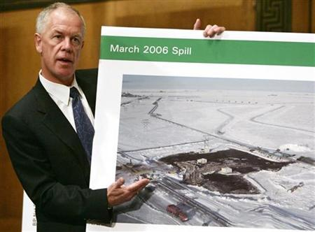 President of BP Exploration (Alaska) Steve Marshall holds up a photograph of an oil spill during a Senate Energy Committee hearing on Capitol Hill in Washington September 12, 2006. Congressional investigators have turned up a ''mountain'' of evidence showing that severe cost cutting at BP's Prudhoe Bay oil field in Alaska led to the worst oil spill on the North Slope last March, the chairman of the subcommittee investigating the spill said on Wednesday. REUTERS/Jim Young