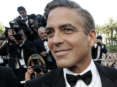 George Clooney arrives for the world premiere of Steven Soderbergh's film ''Ocean's 13'' at the 60th Cannes Film Festival, May 24, 2007. REUTERS/Yves Herman