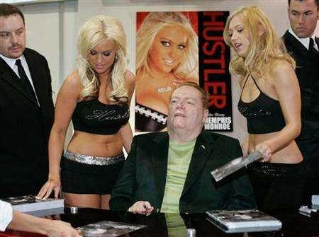 Hustler magazine publisher Larry Flynt (C) signs autographs during the AVN Adult Entertainment Expo in Las Vegas, Nevada January 6, 2006. Hustler magazine is looking for some scandalous sex in Washington again -- and willing to pay for it. REUTERS/Steve Marcus