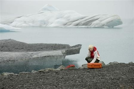 Glaswegian artist Katie Paterson shown in this undated photo handout. The creaking and splashing sounds of Europe's largest glacier slipping into its icy ocean grave are just a phone call away after an artist installed a microphone in its surrounding waters. REUTERS/Handout