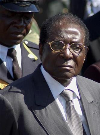 Zimbabwe's President Robert Mugabe arrives at the burial of national hero Paul Gunda in Harare June 27, 2007. President Mugabe's government has warned it will arrest white Zimbabwean farmers resisting evictions from new land targeted for black farmers, state media reported on Wednesday. REUTERS/Philimon Bulawayo