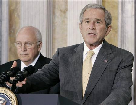 U.S. President George W. Bush (R) seen speaking to the media after a meeting with members of his economic advisory team at the Treasury Department in Washington, August 8, 2007. REUTERS/Larry Downing