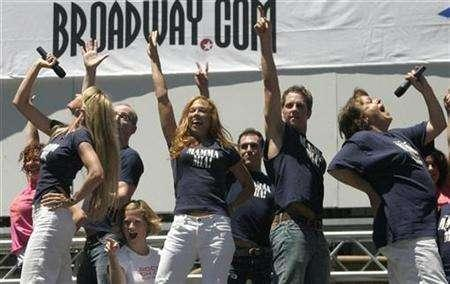 Cast members of the musical production ''Mamma Mia!'' perform during a presentation of ''Broadway in Bryant Park'' in New York July 12, 2007. The British producer behind the West End and Broadway hits ''Cats'', ''Les Miserables'' and ''Mary Poppins'', among others, said he is bringing a revolution to China by introducing the Chinese versions, including ''Mamma Mia!'' REUTERS/Jamie Fine