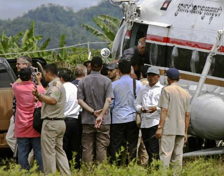 The most senior surviving leader of the Khmer Rouge, ''Brother Number Two'' Nuon Chea (top), boards a helicopter near the Cambodia-Thai  border at Phsar Prom village in Pialin province, about 421 km northeast of Phnom Penh, on September 19, 2007. REUTERS/Chor Sokunthea