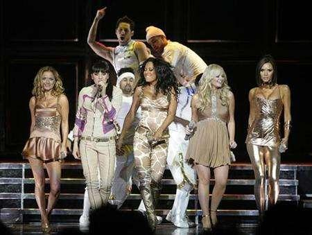 The Spice Girls, (from L to R) Geri Halliwell, Melanie Chisholm, Melanie Brown, Emma Bunton and Victoria Beckham, perform as they kick off their reunion tour in Vancouver, British Columbia December 2, 2007. REUTERS/Lyle Stafford