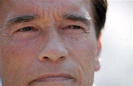 California's Governor Arnold Schwarzenegger in San Diego, October 28, 2007. Schwarzenegger said on Thursday that he would sue the U.S. government for not granting a waiver that would allow his state to enforce new standards on motor vehicle emissions. REUTERS/John Gress