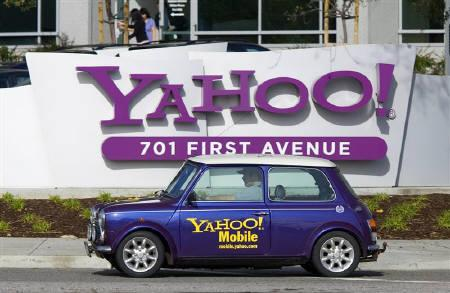 A man drives a Mini Cooper with a Yahoo! logo in front of Yahoo! headquarters in Sunnyvale, February 1, 2008. Yahoo Inc employees fretted on Friday that their fun-loving culture, summed up by early company ads featuring a cowboy yodel, could get quashed by the comparatively stodgy software behemoth that wants to gobble it up. REUTERS/Kimberly White