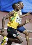<p>In primo piano il giamaicano Usain Bolt . REUTERS/Issei Kato</p>