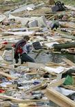 <p>Le rovine che si è lasciato alle spalle un tornado a Hugo, nel Minnesota, due giorni fa. REUTERS/Andy King (UNITED STATES)</p>