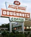 <p>A Krispy Kreme Doughnuts location in a file photo. Krispy Kreme Doughnuts posted a profit for the first quarter as the doughnut shop chain's turnaround efforts helped in trimming costs. REUTERS/Richard Clement</p>