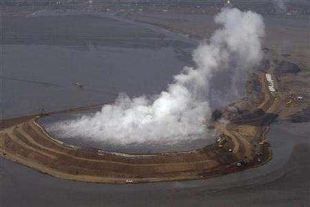 An aerial view of the gas emission from the crater of a mud volcano in Porong, East Java province in this file photo from May 29, 2008. The volcano, which started spewing hot mud in Indonesia two years ago, displacing more than 50,000 people, was triggered by tectonic activity, experts working for the energy firm blamed by some for the disaster said on Thursday. REUTERS/Sigit Pamungkas (INDONESIA)