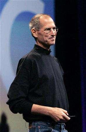 In this file photo Apple Corporation CEO Steve Jobs speaks about the new iPhone 3G during his keynote speech at the Apple Worldwide Developers Conference in San Francisco, California June 9, 2008. The U.S. Justice Department has decided not to file charges against Apple Inc leader Steve Jobs and other current or former executives in a probe of backdated employee stock options, lawyers for the people targeted in the investigation said on Wednesday. REUTERS/Kimberly White