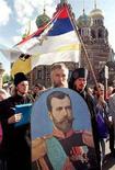 <p>Il ritratto dell'ultimo zar di Russia, Nicola II, durante una manifestazione a Mosca. MF/EB</p>