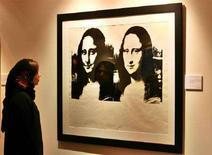 <p>Doppia Mona Lisa di Andy Warhol REUTERS/Ahmed Jadallah</p>