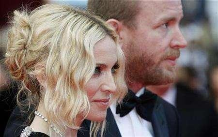 Singer Madonna (L) and director Guy Ritchie arrive on the red carpet at the 61st Cannes Film Festival May 21, 2008. REUTERS/Vincent Kessler