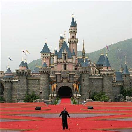 Walt Disney Company CEO Robert Iger speaks in front of the Sleeping Beauty Castle during the opening ceremony of Hong Kong Disneyland in this September 12, 2005 file photo. REUTERS/Bobby Yip