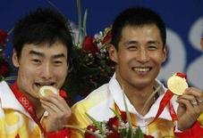<p>I cinesi Wang Feng e Qin Kai, oro nel tuffo sincronizzato dal trampolino a 3 metri. REUTERS/Jason Reed (CHINA)</p>