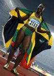 <p>La giamaicana Veronica Campbell-Brown festeggia la vittoria nei 200 metri. REUTERS/Jerry Lampen (CHINA)</p>