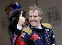 <p>Il pilota di Toro Rosso Sebastian Vettel dopo la sua prima pole position, a Monza. REUTERS/Alessandro Bianchi</p>