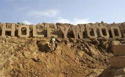 <p>Scultura di sabbia a Pera, Portogallo. REUTERS/Hugo Correia</p>