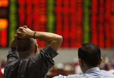 <p>Trader al lavoro. REUTERS/Darren Whiteside</p>
