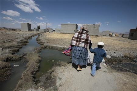 Andean farmers yearn for Bolivia's warmer climate...